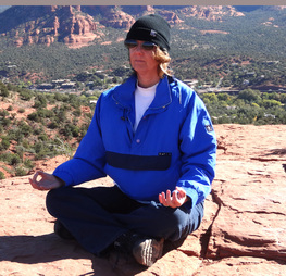 Peggy Steffens meditating in Sedona at Airport Mesa Vortex